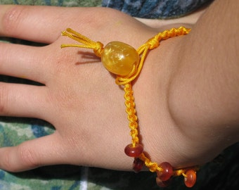 Nicole Wong hand knotted saffron bracelet with beeswax & horn