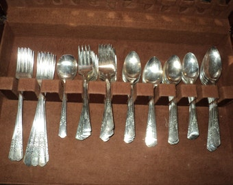 Antique 62 Piece Silver plated Silverware Set of Extra Silver plated Forks, Knives and Spoons contained in a felt lined box, Oneida, LTD