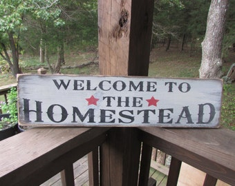 """primitive sign """"welcome to the homestead"""" primitive decor ,made of wood, white washed, and distressted to give a primitive rustic look"""
