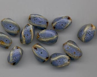 Twelve lovely porcelain beads - periwinkle blue spattered with brown - 16 x 10.5 mm twisted ovals