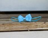 turquoise butterfly headband on skinny elastic