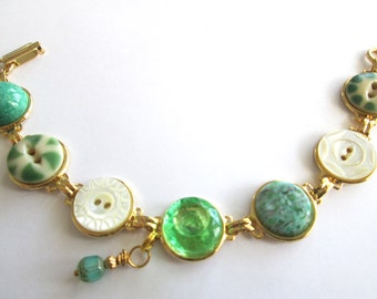 GREEN antique button bracelet. Carved mother of pearl, china and glass buttons