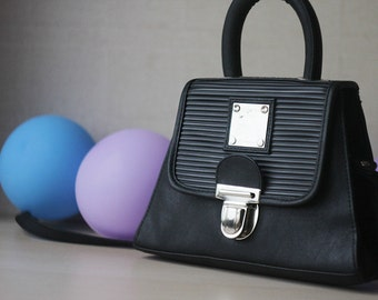 Black faux leather mini handbag