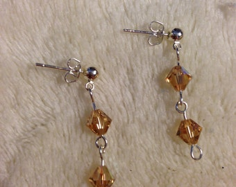 Genuine Swarovski crystal earrings in amber on hypoallergenic steel posts