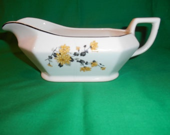 One (1), Gravy Boat, from Homer Laughlin, in a Unknown Pattern.