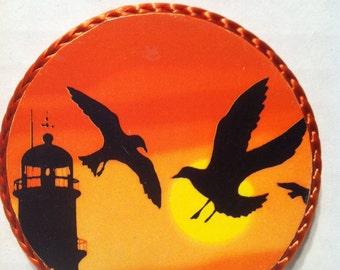 Seagulls flying near lighthouse magnet ,1990's