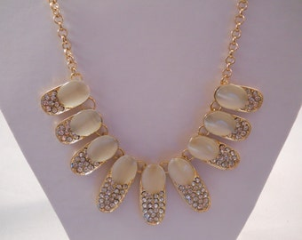SALE Bib Necklace with Gold Tone  Mother of Pearl and Clear Rhinestones Pendants on a Gold Tone Chain.