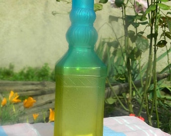 Blue and green yellow colored bottle