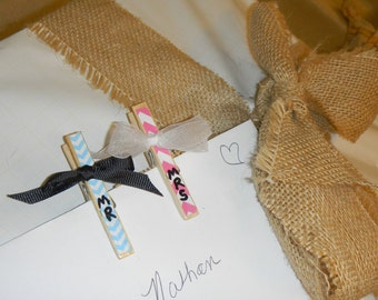 Two sweet little decorated clothespins