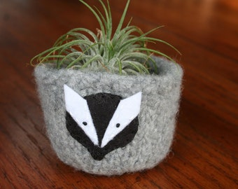 grey wool felted bowl cup with woodland badger face
