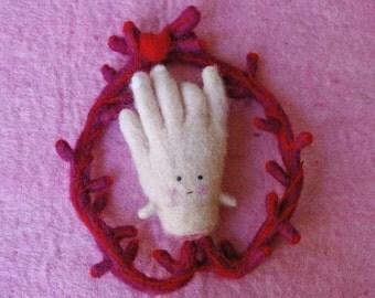 Ex-voto garland with a hand