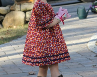 Prairie-style dress for toddler/girl, slip-on dress, puffed sleeves, dress with rick rack trim, red/yellow/blue floral print, size 2 only.