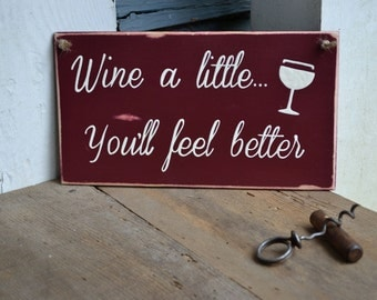 wine a little... you'll feel better, wood sign