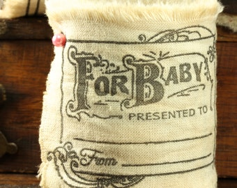 It's A Girl It's A Boy - Vintage Inspired Hand-Stamped Tea Dyed and Frayed Muslin Trim Around A Charming Wooden Spool