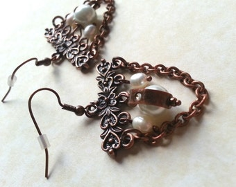 Pearl Enchained earring - Upcycled faux pearls on a floral copper coloured bar with copper chain