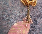 Pink and gold locs jewelry with pink crystals