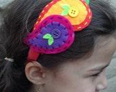 Handmade wool felt headband. Colorful pasley design