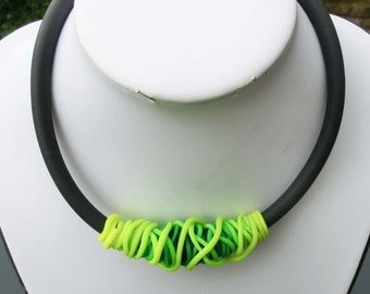 Neon yellow green necklace/ thin Fimo tubes shaded colours on 8 mm. rubber tube/ polymer clay bow shape/ choose length