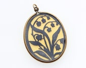 Antique Victorian Lily of the Valley mourning pendant, black and cream celluloid in gold frame