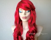 Red wig. Mermaid cosplay wig. Long curly red hair with long side bangs wig. Red mermaid costume wig. Halloween costumes. Adult costumes.