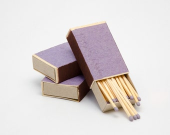 Three matchboxes, wooden matches with grey heads inside, striker from two sides
