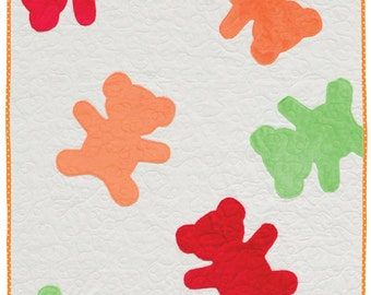 Gummie Bears quilt kit and Nap and Nod book.  Cuddle gummie bears of red orange and lime green with a large rainbow dot fabric