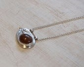 Sea series  Sea pebble necklace, silver, soft red moonstone cabachon and 18ct gold