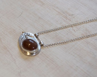 Silver 925 and Red moonstone pebble necklace.  Sea pebble series pendant.