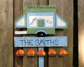 Popup camper camping sign with hanging family names