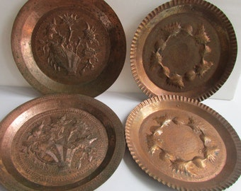 Four Vintage Hammered Copper Plates Wall Hangings