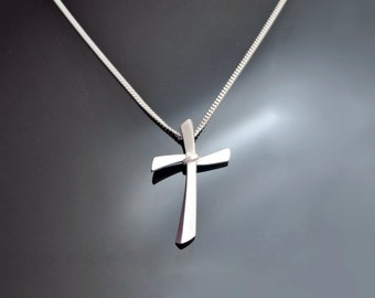 Silver Curved Cross. The curved lines give the cross a modern feel.