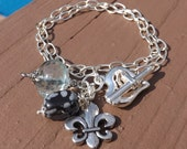 Sterling Silver Bracelet with Heart and Arrow Clasp, Topaz Quartz, Snowflake Obsidian and Fluer De Lis