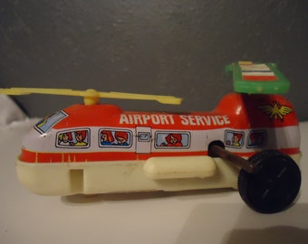 vintage friction tin airplane helicopter