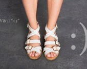Sandals.  Valerio White sandals. Summer shoes, White leather straps with three buckles. Cork padding with a hint of gold.