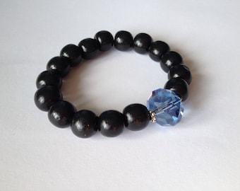 CLEARANCE *** Black wood beads bracelet with a blue glass rondel