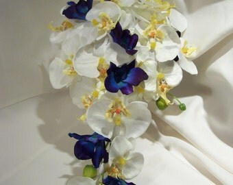 Cara's Cascade Bridal Bouquet with White Phalaenopsis Orchids, accent of Blue Violet Dendrobium Orchids.