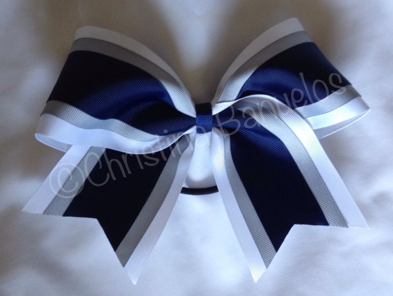 Cheerleading bows blue and white