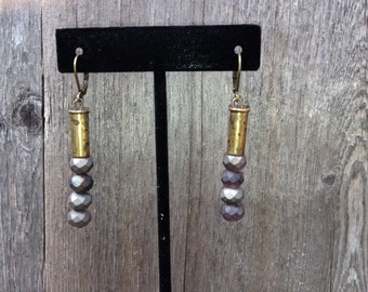 Purple/gray cut glass bead earrings with .22 shell casing housing