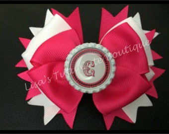 Stacked boutique bow with letter center.
