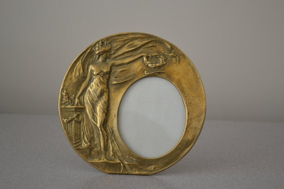 vintage round brass art nouveau picture frame with lady