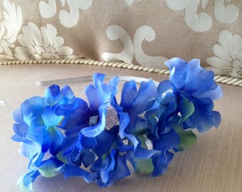 Pretty blue flowered fascinator on a silver headband!