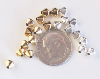 Nickel free silver or gold tone bicone beads for jewelry.