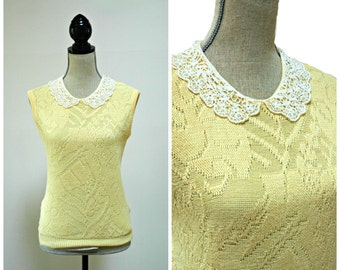 Soft yellow sleeveless knit top with ivory lace peter pan collar. Sleeveless sweater.