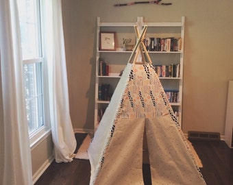 canvas teepee hand stamped with floral accent and poplar dowel poles.
