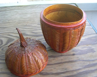 a lovely large covered Acorn Basket