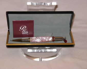 Diva Charm Red Crystal Twist Style Pen in a Rhodium and Gold T/N(Pink Aqua Pearl Acrylic Blank)(includes a felt lined pen box)