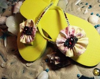 Gorgeous size 9 yellow swarovski crystal flip flops with red gem