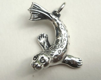 Seal necklace , sterling silver charm pendant.