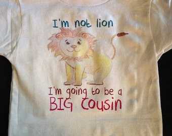 lion big cousin shirt. crayon type writing. long sleeve or short sleeve im not lion im going to be a big cousin shirt in pink writing