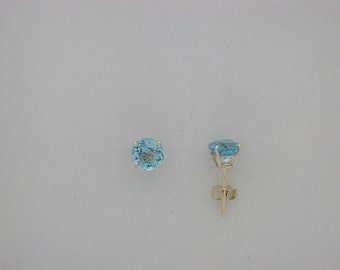 Genuine Blue Topaz Stud Earring 14kt Yellow Gold